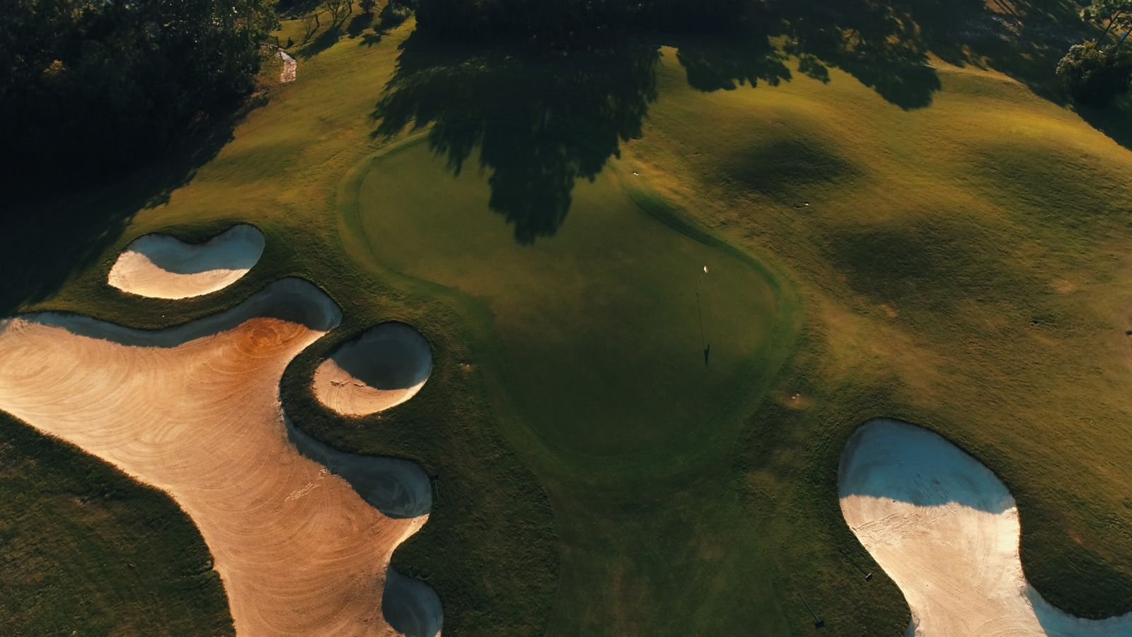 An aerial view of a few sand traps on the course at Shell Landing Golf Club